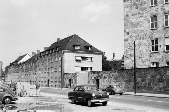 University of Maryland, Munich Campus--Men's dorms (4 buildings - note roof lines) and a corner of the HQ building as seen from Soyerhofstrasse.  The dorms formed part of the Kaserne wall.  The doors were sealed off from this side so the dorms could only be accessed from inside the Kaserne. Photo: Kent Price